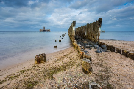 babie: Beautiful view on Baltic sandy coast with old military buildings from world war II and wooden breakwaters. Long exposure photo