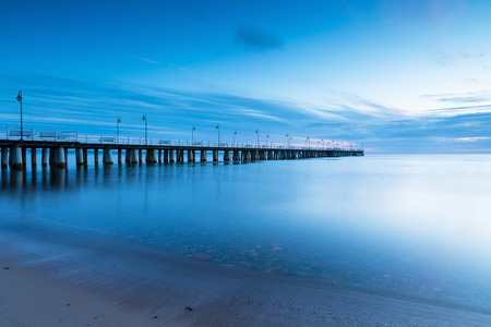 Beautiful pier in Gdynia, poland. Seascape with wooden molo in Orlowo. Landscape photographed before sunrise
