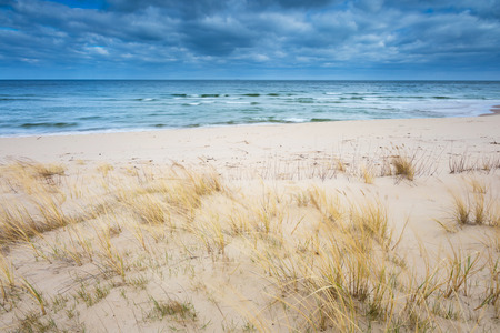 spring tide: Beautiful view on Baltic sandy coast photographed on middle of the day. tranquil landscape