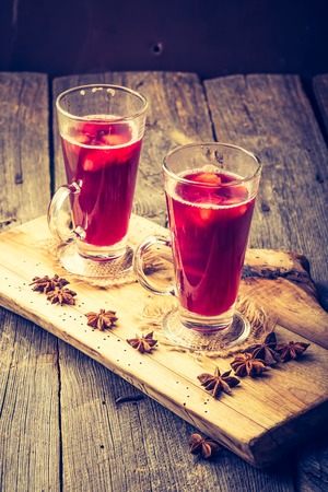 Vintage photo of glasses with mulled wine. Christmass drink Stock Photo