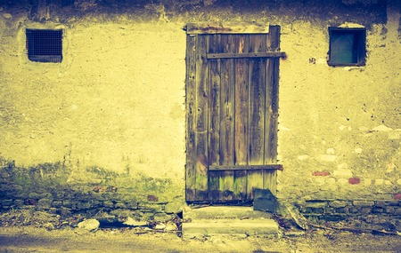 shanty: Vintage photo of wall of old abandoned building with wooden doors Stock Photo