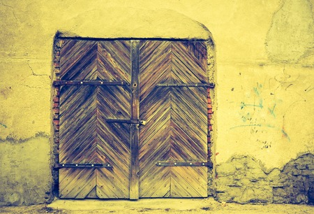 parget: Vintage photo of wall of old abandoned building with wooden doors Stock Photo
