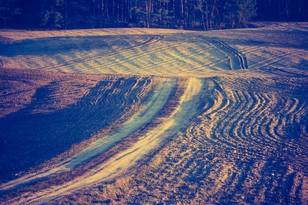 lomography: Vintage photo of plowed field in calm countryside