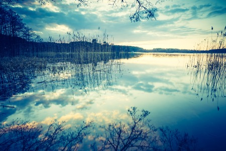 warmia: Vintage photo of sunset lake, calm landscape with old photo mood.