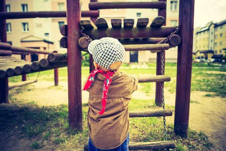 Vintage photo of Little child playing outdoor. photo with old colors effect photo