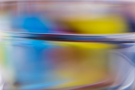 opalescent: Abstract background of color reflections in thick glass vase