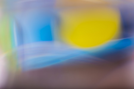 Abstract background of color reflections in thick glass vase