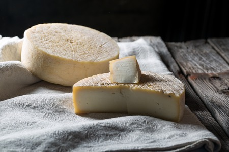Still life with french goat cheese. Studio shoot with mystic light efect. Standard-Bild