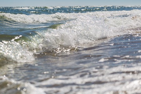 wavely: Splashing waves on sea shore. Photo of sea photographed on shallow depth of field