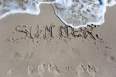 orthographic symbol: Inscription on beach sand. Sea shore close up with inscription. Summer