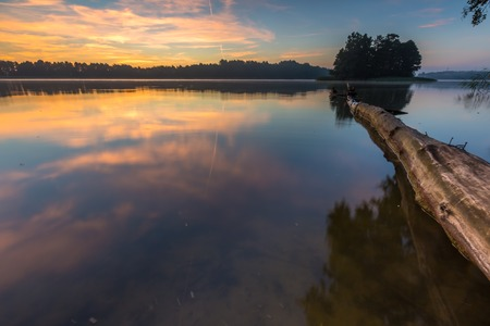warmia: Beautiful sunrise over mysty lake. Lake in Warmia and Mazury lake district in Poland. Summer calm weather Stock Photo