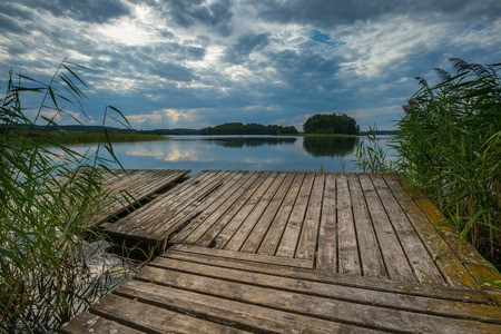 warmia: Beautiful lake with old destroyed jetty. Lake near Olszty in Poland, Mazury lake district