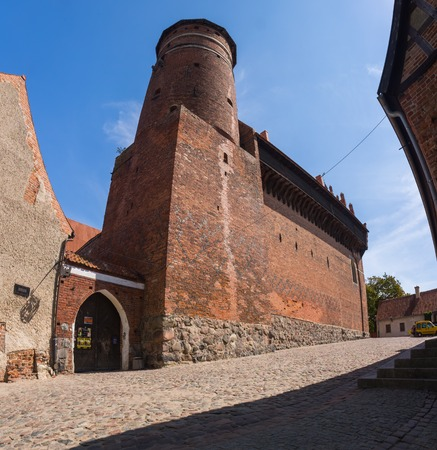 crusaders: OLSZTYN, POLAND - AUGUST 21, 2015: Old teutonic castle in Olsztyn (Gothic Crusaders castle), tourist attraction of eastern Poland