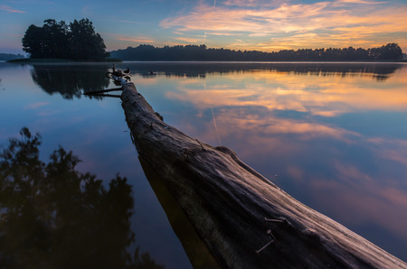 Beautiful sunrise over mysty lake. Lake in Warmia and Mazury lake district in Poland. Summer calm weather Stock Photo