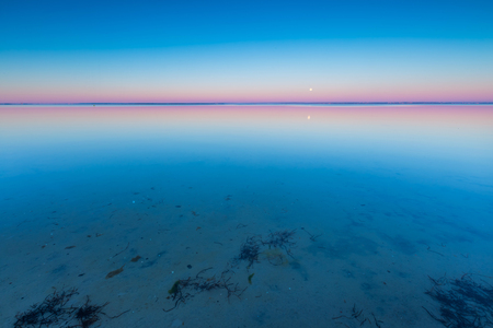 sunrise ocean: Beautiful beach before sunrise. Landscape of gdanska bay photographed on Jastarnia in Poland
