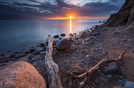 Beautiful long exposure landscape of rocky sea shore. Tranquil scene of Baltic sea.