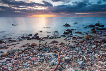seashores: Beautiful long exposure landscape of rocky sea shore. Tranquil scene of Baltic sea.