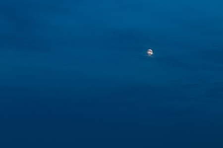 fool moon: Beautiful almost fool moon on dark evening sky with clouds. Nature sky background