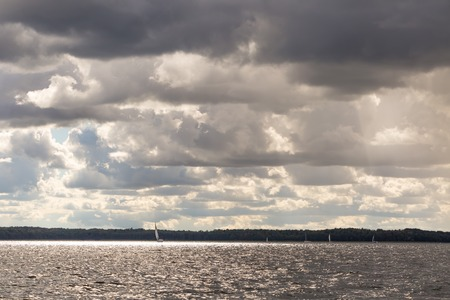 mazury: Lake landscape at storm photographed from yacht. Landscape with yachts on lake. Mazury lake district.