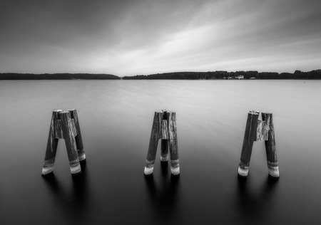 landscape architecture: Black and white landscape with metal construction on city beach of Olsztyn in Poland. Long exposure landscape with architecture elements.