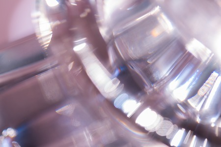 opalescent: Thick glass abstraction made with glass vase and glass on shallow depth of field.
