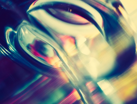 penetrate: Vintage photo of thick glass abstraction made with glass vase and glass on shallow depth of field. Stock Photo