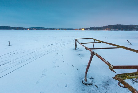 windlass: Frozen lake landscape. Beautiful lake in Poland old metal construction of boats hoist