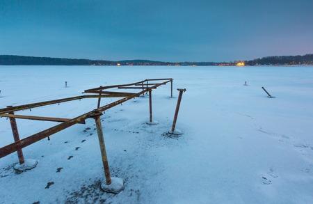 windlass: Frozen lake landscape. Beautiful lake in Poland old metal construction of boats hoist