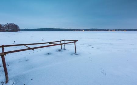 hoist: Frozen lake landscape. Beautiful lake in Poland old metal construction of boats hoist