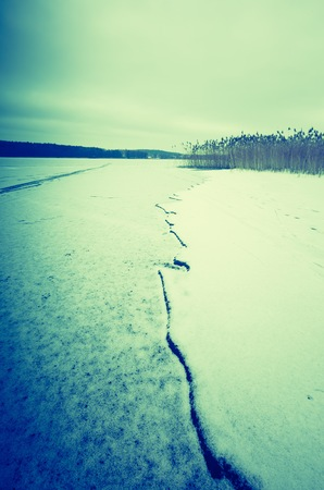Vintage photo of frozen lake at winter. Natural landscape with filtered look. Stock Photo