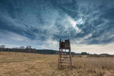 Early spring meadow landscape in Poland. Beautiful polish landscape with raised hide Stock Photo