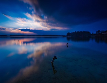 lake sunset: Long exposure lake landscape photographed at sunset. Lake Krzywe in Olsztyn, Mazury lake district Stock Photo
