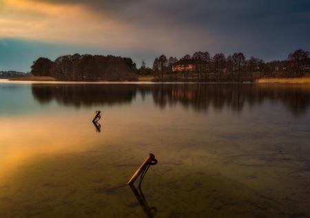 long lake: Long exposure lake landscape photographed at sunset. Lake Krzywe in Olsztyn, Mazury lake district Stock Photo