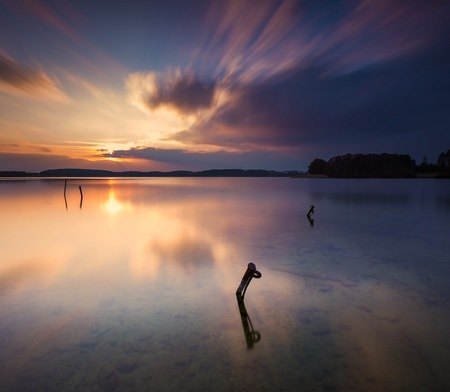 long lake: Long exposure lake landscape photographed at sunset. Lake Krzywe in Olsztyn, Mazury lake district Stock Photo
