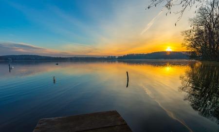 lake district: Sunrise over beautiful lake in Mazury lake district. Morning in Poland. Lake alndscape at sunrise