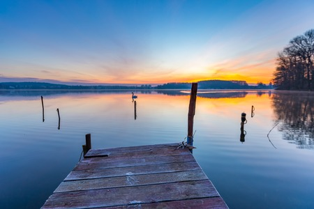 Sunrise over beautiful lake in Mazury lake district. Morning in Poland. Lake alndscape at sunrise