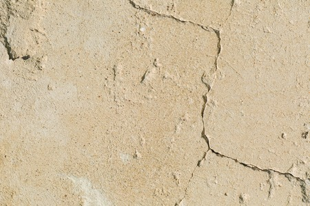 ruinous: Old concrete wall background. Destroyed wall with cracks.