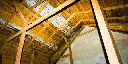 Very old barn interior. Close up of inside of barn, dark photo.