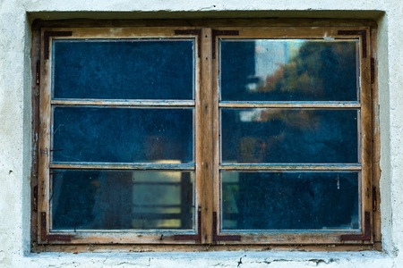 abandonment: Old abandoned window, detail of a window of a house in ruins, evictions and abandonment, crisis