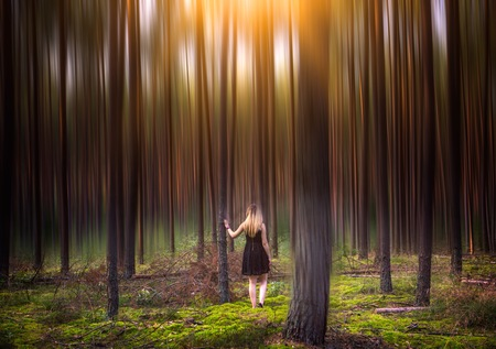 Portrait of young blonde girl in european forest Stock Photo