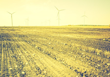 lomography: Vintage photo of field with windmills. Polish autumn landscape with filtered look.