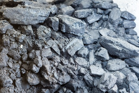 Black coal lying on a pile in house basement. Fuel material.