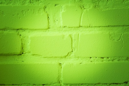 Brickwall painted. Close up of old brick wall with color. Stock Photo