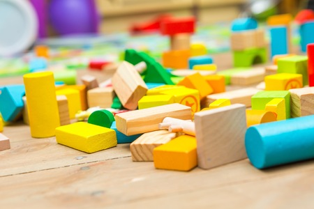 wooden blocks: Wooden blocks lying on floor. Close up of children toys