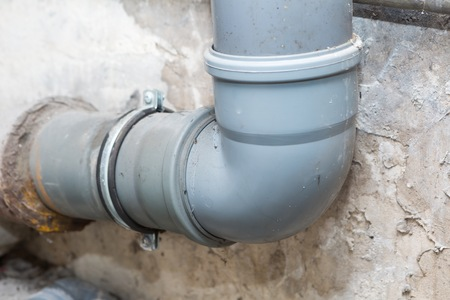 sedimentation: Sewer pipes in home basement. System of gray sanitary pipes in old house.