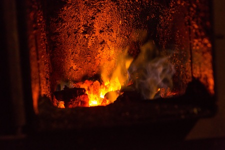 fuel chamber: Fire in fireplace. Close up of hot red fire from coal in central heating stove.