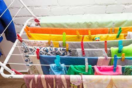 Close up clothes dryer and plastic clips. House clothes drying equipment. Stock Photo