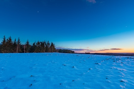 northern light: Beautiful winter after sunset landscape of fields. Long expoure of european fields in winter. Colorful landscape Stock Photo