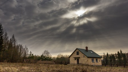 residental: Landscape with house at day under cloudy sky. Spooky landscape with house in cloudy dull day.