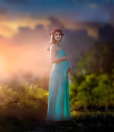 Pregnant woman outdoor portrait. Beautiful caucasian pregnant woman. Stock Photo